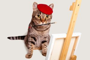 絵筆をくわえたネコ